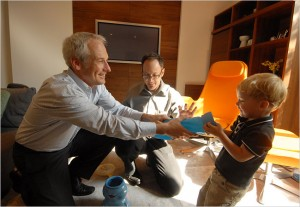 Two-year-old Evan plays with his dads, Kevin Yoder, right, and Harvey Hurdle at their Philadelphia home.